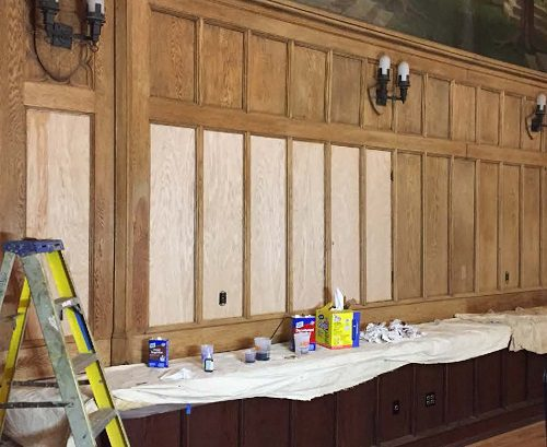 BC Gasson Hall Replacement panels lighter than existing stripped woodwork.